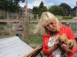 School Gardening Teacher, Caroline Jolly, with one of the St Brigid's School hens.