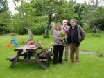 Garden volunteer Rita O'Sullivan creating floral works of art in Sonairte with botanist Dr Declan Doogue and his Dad, Éamon.