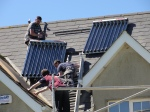The team from Kelly's Insulation & Plumbing, Wexford lifting Italian made solar panels into place.
