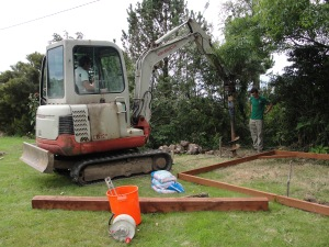John's mini-digger twists the augur in 3 foot where the first of 4 storm proof posts are to stand!