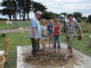 One of the cob mixing teams hard at 'work'. Meet Peter, Niamh, Ailis, Dana and Theo dancing for their supper!